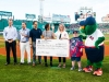 New Hampshire Day impact honorees are presented a check during pre-game at Fenway Park in Boston, Massachusetts Thursday, July 26, 2018.